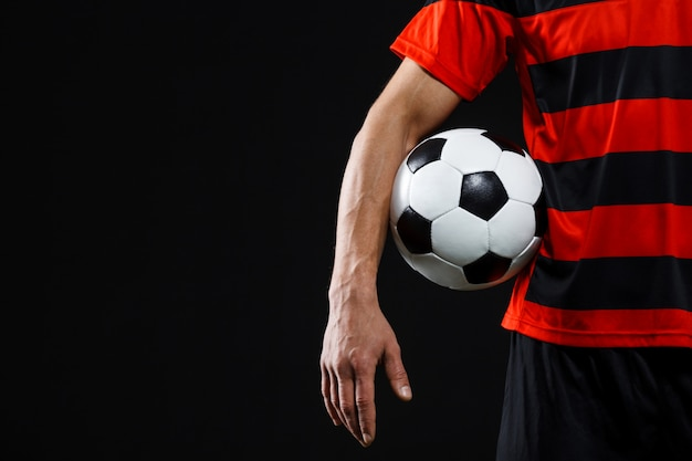 Confident soccer player with ball, play footballl Free Photo