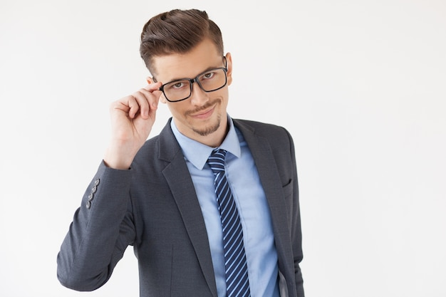 Confident Stylish Business Leader Adjusting Glasses Free Photo