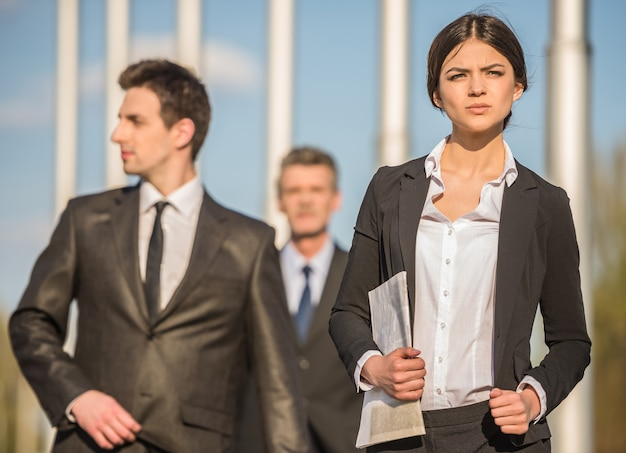 Confident successful businesspeople in suits at a meeting. Premium Photo
