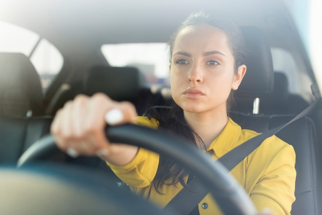 Confident woman driving her car Free Photo