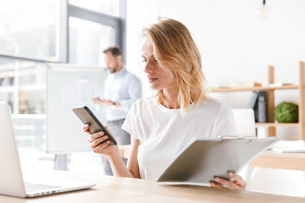 Confident woman manager working with laptop computer Premium Photo