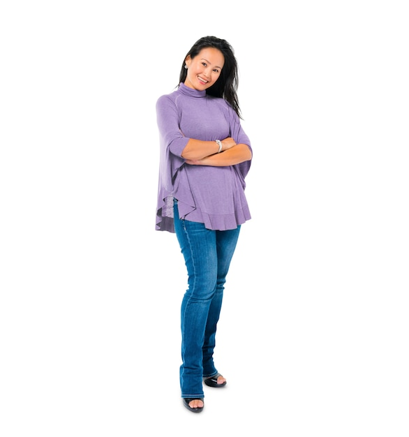 Confident woman standing with arms crossed Free Photo