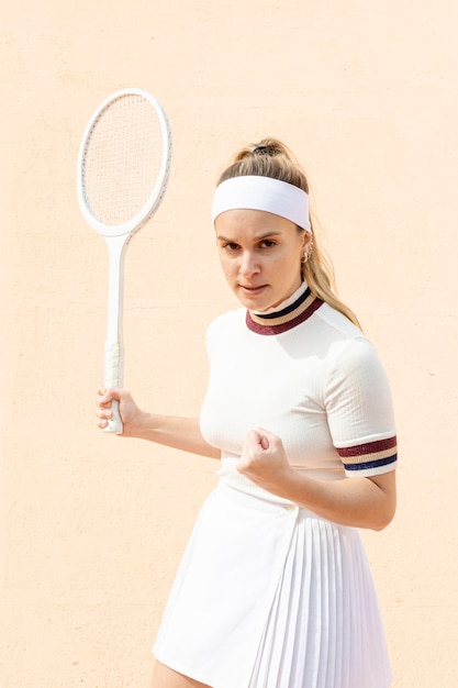 Confident woman tennis player of result Free Photo