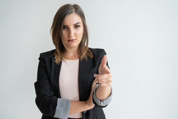 Confident young caucasian woman in smart suit pointing at you Free Photo