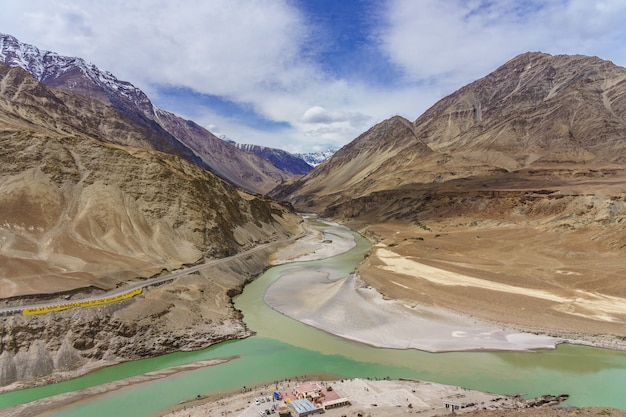 Confluence of the indus and zanskar rivers are two different colors of water Premium Photo