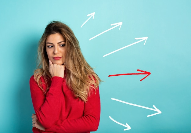 Confused woman have to choose the right arrow to follow. concept of options, confusion, decision. Premium Photo