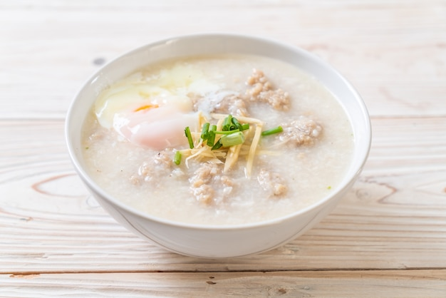 Congee with minced pork in bowl Premium Photo