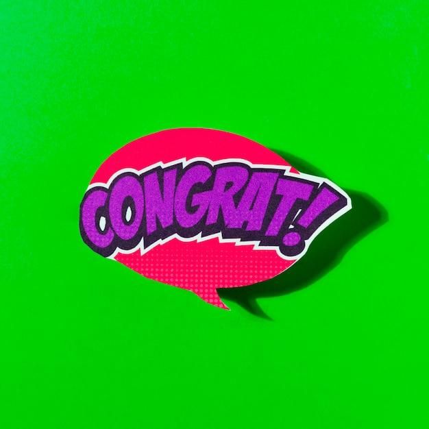 Congrats speech bubble comic explosion pop art style on green background Free Photo