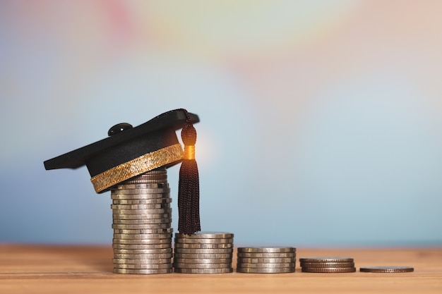 Congratulations graduates on top stacks of coins on wood table Premium Photo