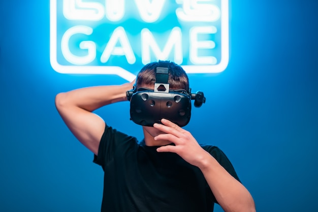 Connecting a person to the internet. virtual reality in a neon room. Premium Photo