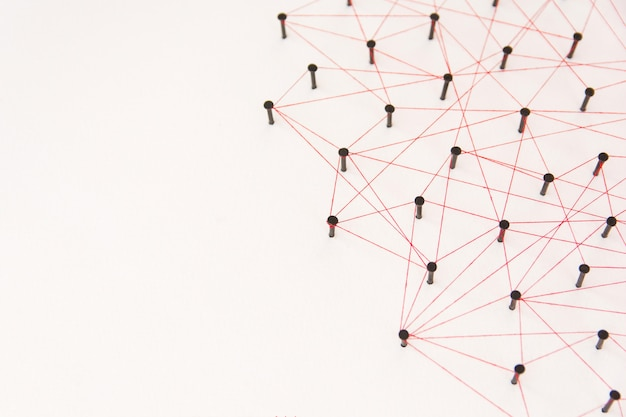 The connection between the two networks. simulation linked together with red thread with copy space Premium Photo
