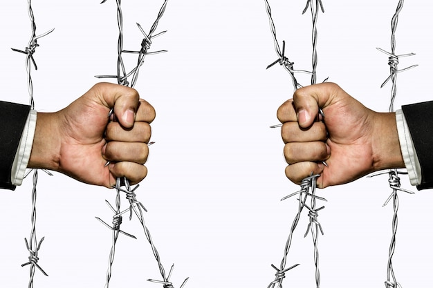 Conqueror barriers behind barbed wire Premium Photo