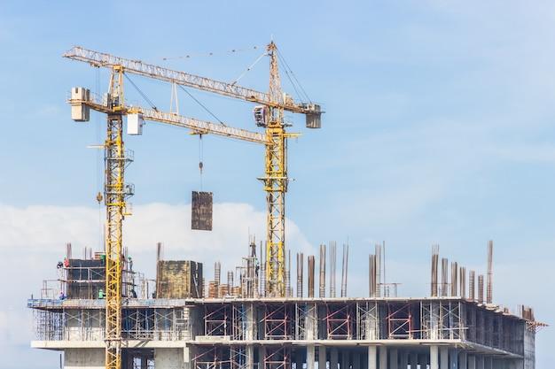 Construction cranes over building site Premium Photo
