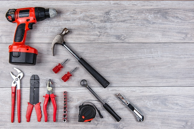 Construction hand tools flat lay on wooden background Premium Photo