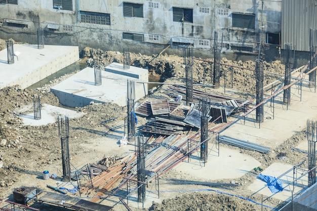 Construction industry, concrete building construction site. Premium Photo
