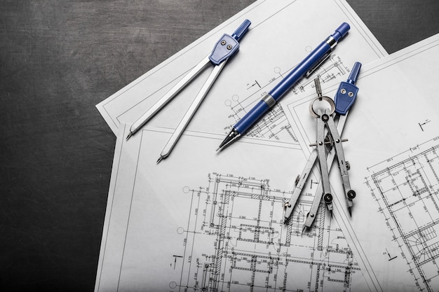 Construction planning drawings on black background Premium Photo