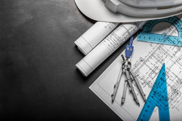 Construction planning drawings on black Premium Photo