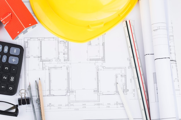 Construction planning with construction drawings and accessories,construction projects on paper Premium Photo