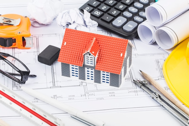 Construction planning with construction drawings and accessories Premium Photo