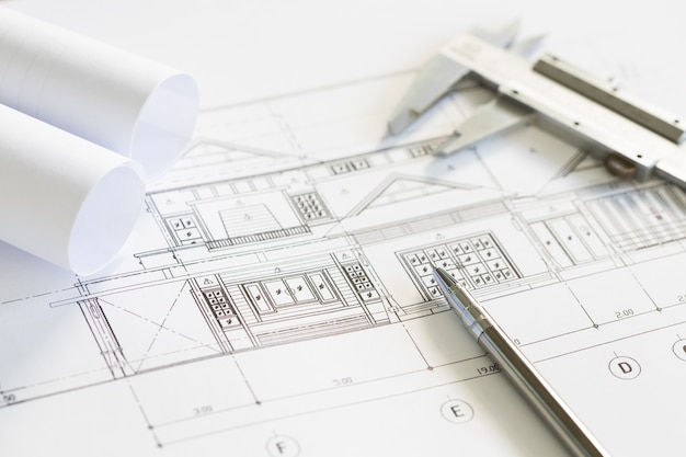 Construction plans and drawing tools on blueprints Free Photo