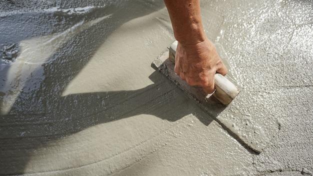 Construction - plasterer concrete Premium Photo