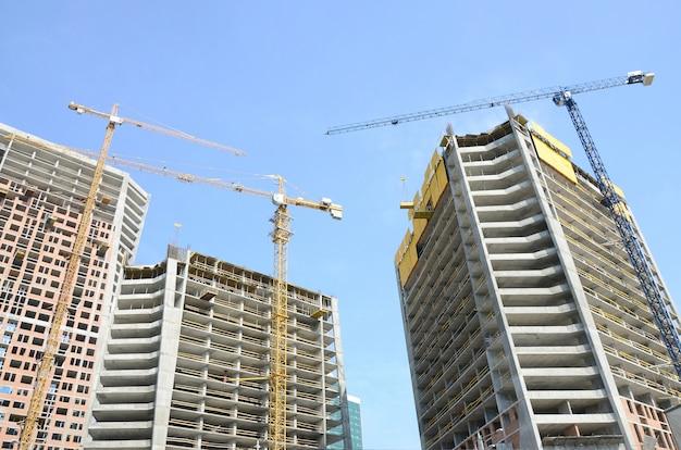 Construction site, high rise multi storey buildings under construction Premium Photo