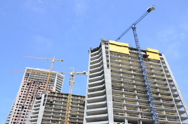 Construction site. high rise multi storey buildings under construction Premium Photo