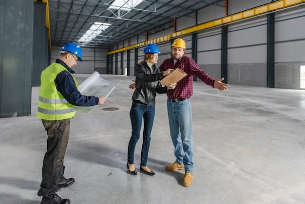 Construction site inspector making report Premium Photo