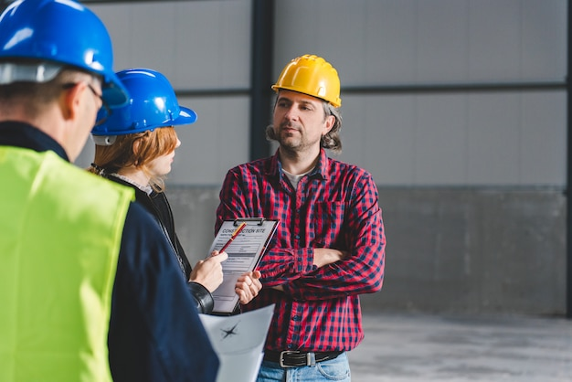 Construction site inspector making report Premium Photo