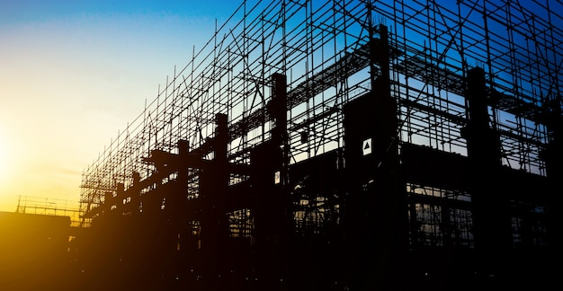 Construction site silhouettes Free Photo