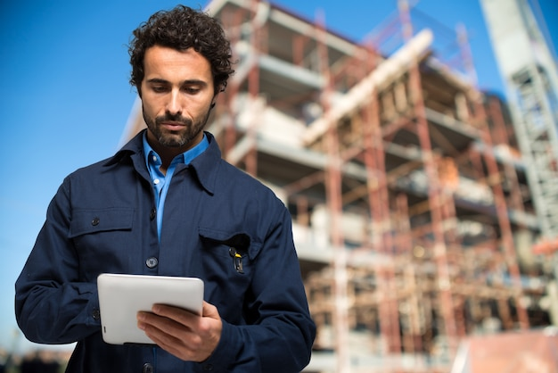 Construction specialist using a tablet computer Premium Photo