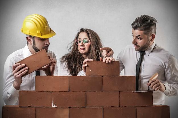 Construction team building up Premium Photo