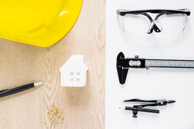 Construction tools around toy house Free Photo