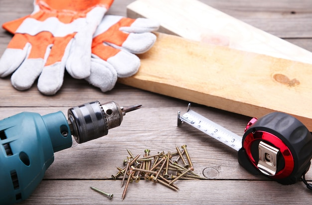 Construction tools on a grey wooden desk. Premium Photo
