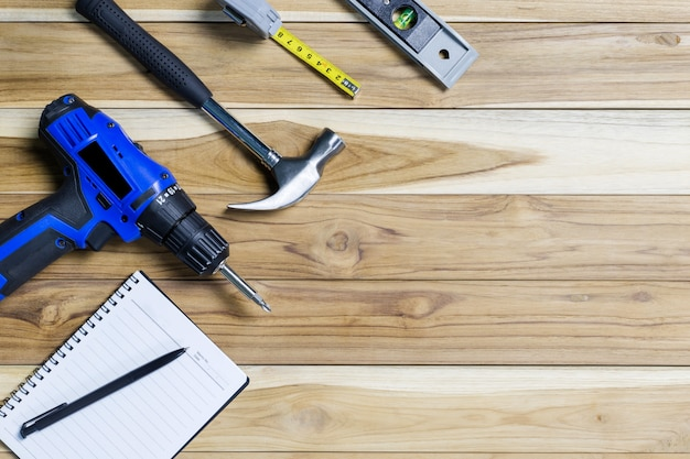 Construction tools and notebook on wooden table Premium Photo