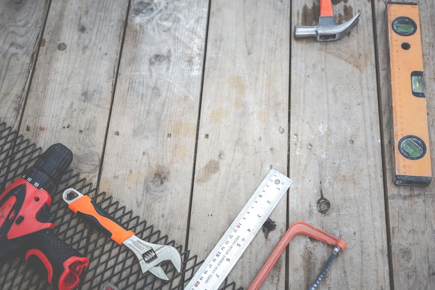 Construction tools placed on wooden floors. Free Photo