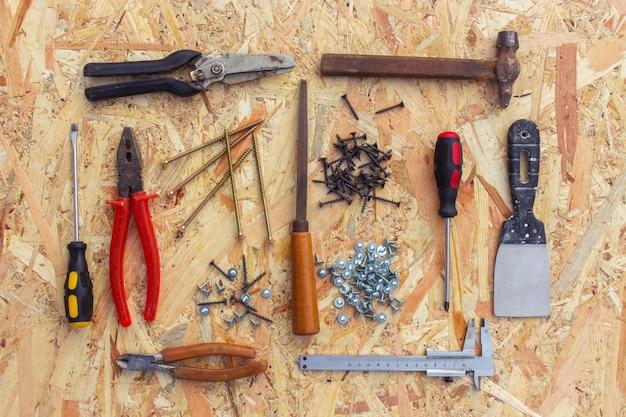 Construction tools: pliers, hammer, shears, screwdriver, pliers Premium Photo