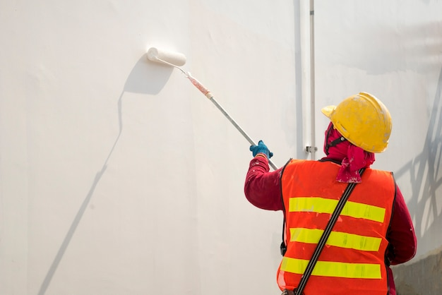 Construction worker painting a wall Photo | Premium Download