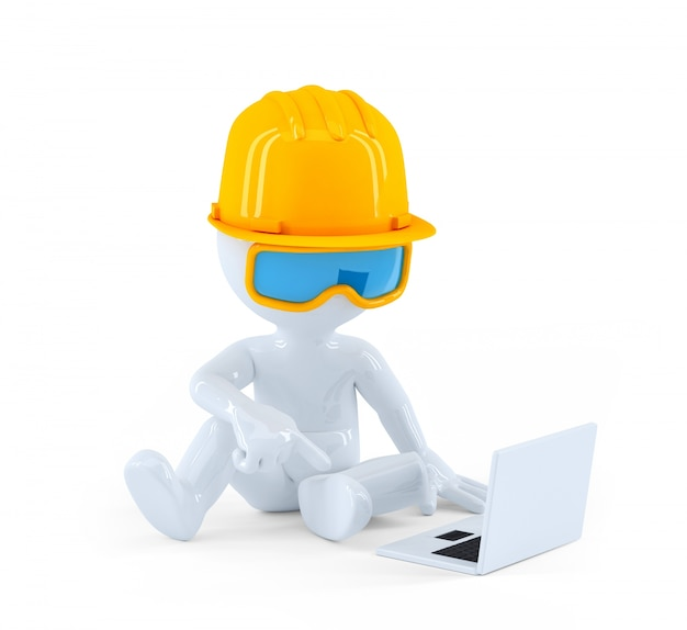Construction worker using laptop computer Free Photo