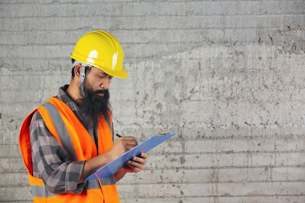 Construction worker with document, plan working for the inside building construction site. Free Photo