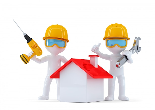 Construction workers with home. isolated. contains clipping path Premium Photo
