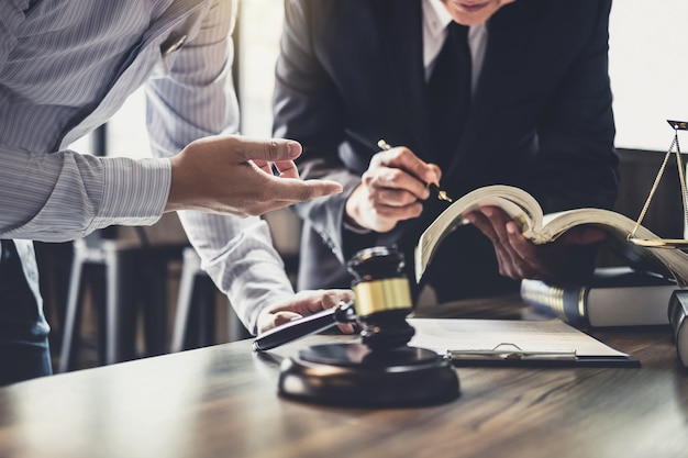 Consultation of businessman and male lawyer or judge counselor having team meeting Premium Photo