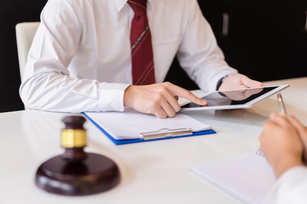 Consultation between a male lawyer and customer about legislation and regulation Premium Photo
