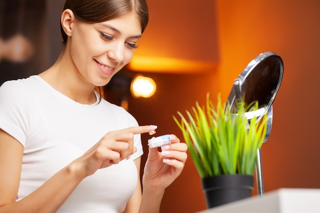 Contact lenses for vision. young woman applies contact lenses Premium Photo