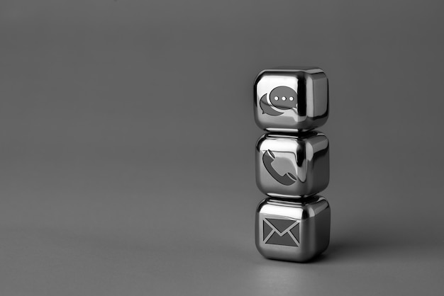 Contact us icon on metal cube for futuristic style Premium Photo