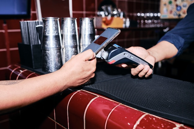 Contactless payment with mobile phone. cashless convenience. Premium Photo