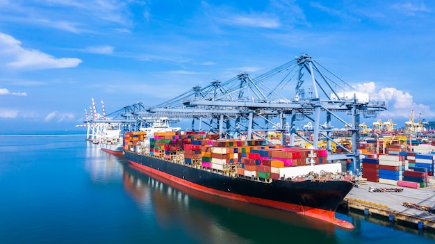 Container ship arriving in commercial port. Premium Photo