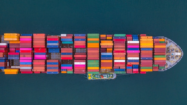 Container ship carrying container aerial view, business import and export logistic and transportation. Premium Photo