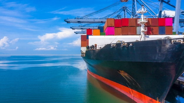 Container ship loading in a port, aerial top view container ship in business import Premium Photo