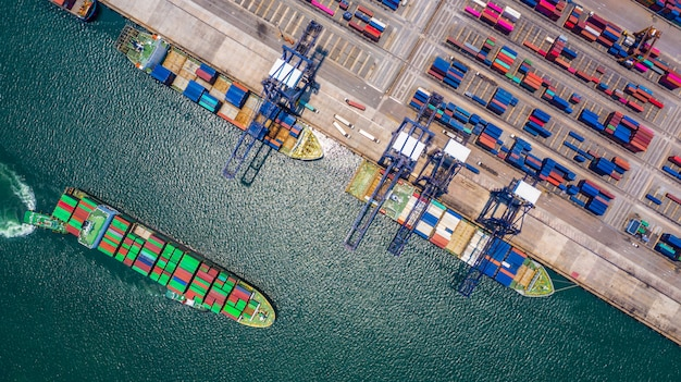 Container ship loading and unloading in deep sea port Premium Photo